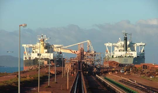 bulk vessels loading iron ore at port